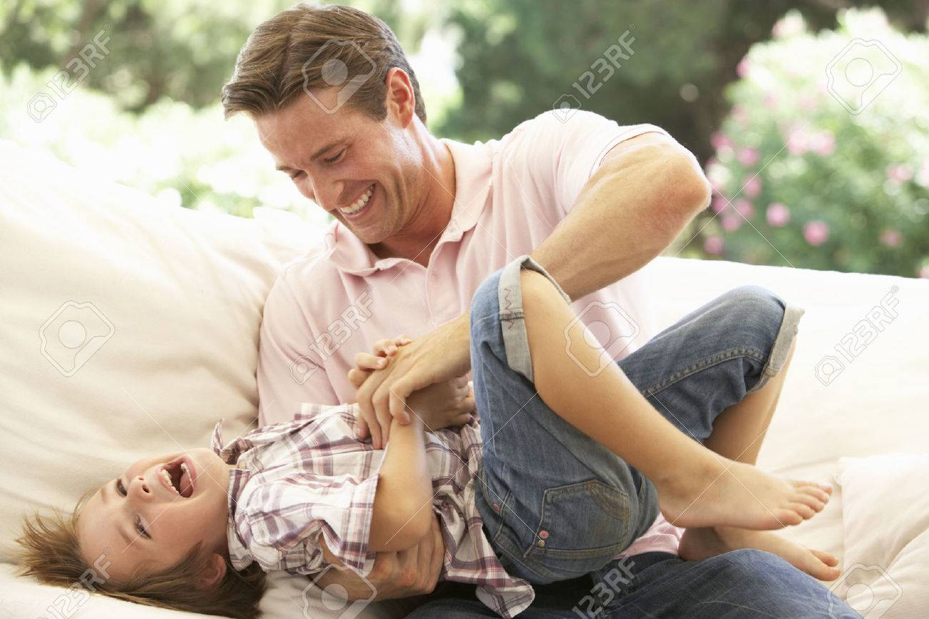 Father With Son Laughing Together On Sofa Stock Photo - 41461863