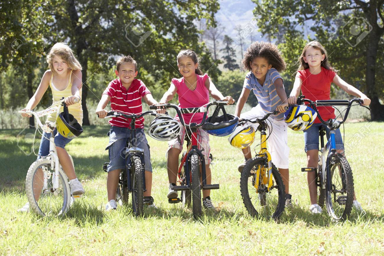 Group Of Children Riding Bikes In Countryside Stock Photo, Picture ...