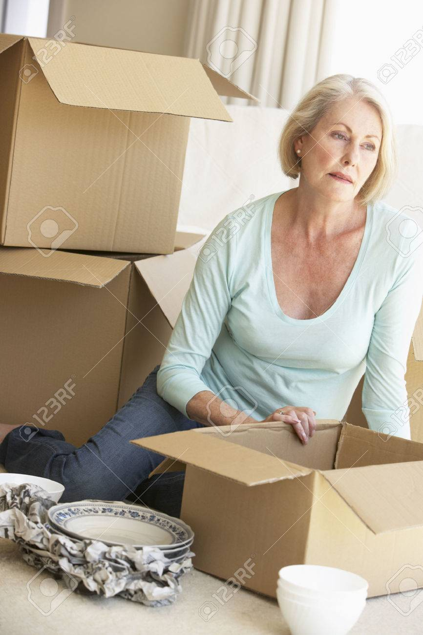 senior woman moving home and packing boxes stock photo picture and