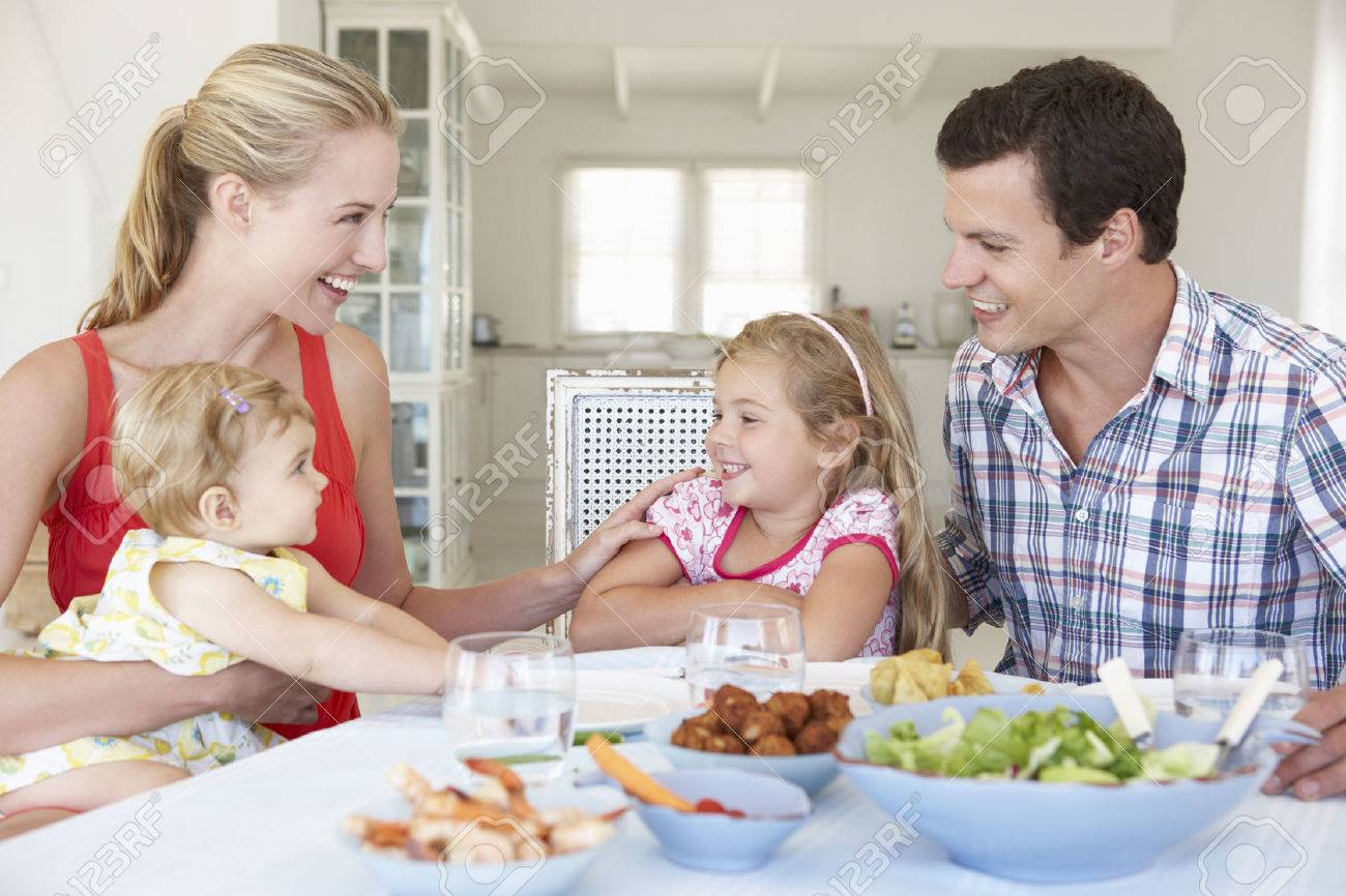 Family Enjoying Meal Together At Home - 41492705