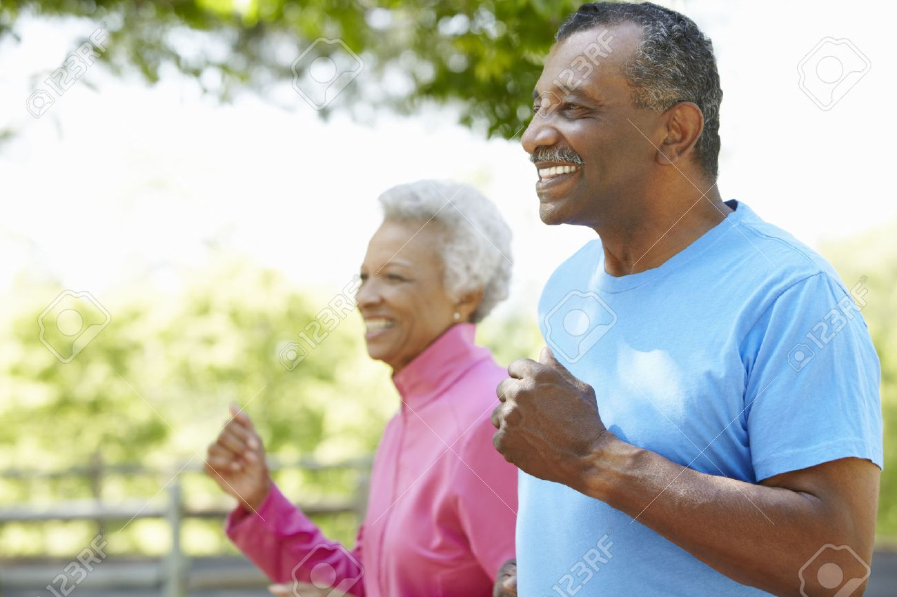 Senior African American Couple Jogging In Park Stock Photo - 42109724