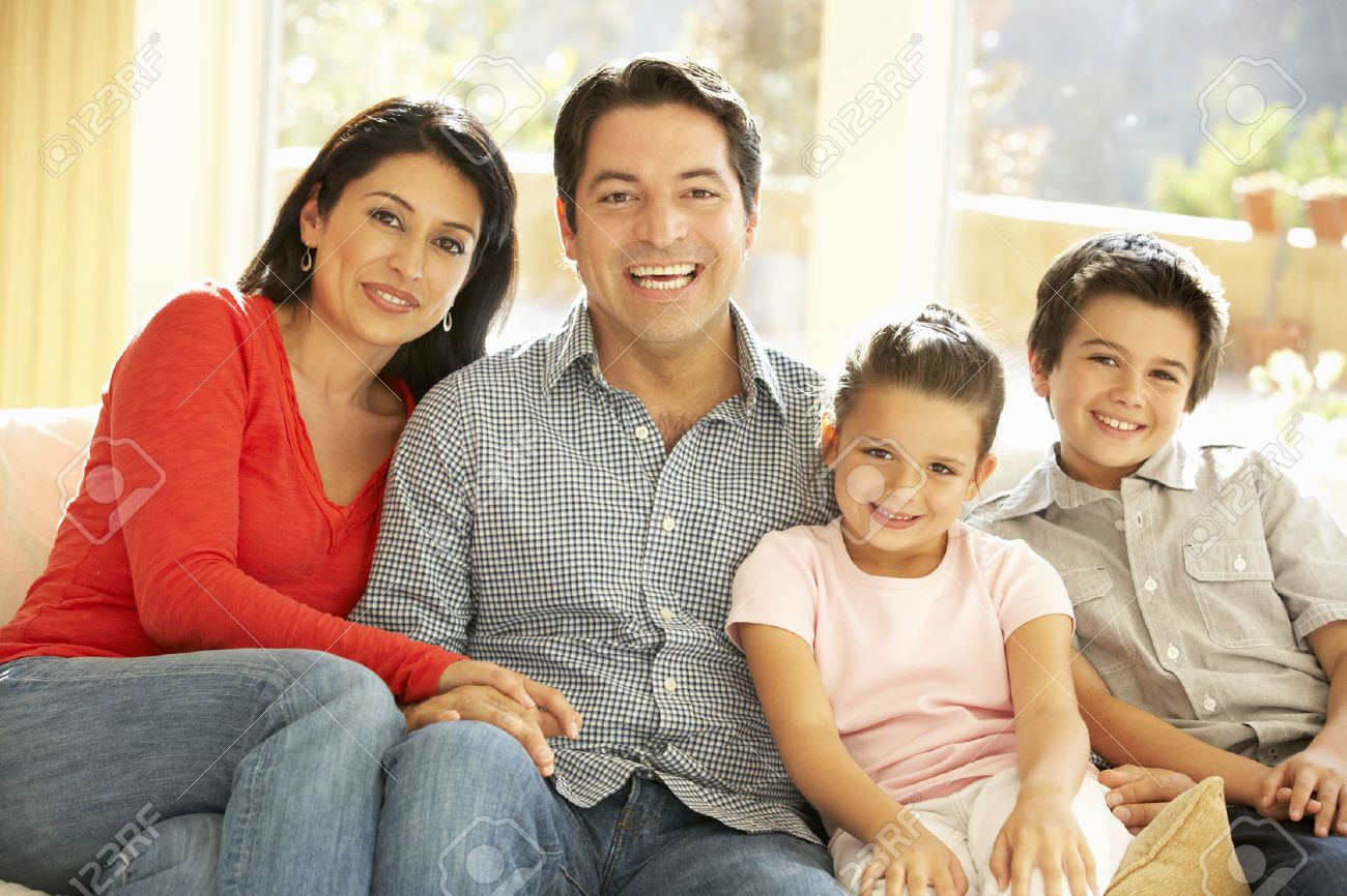 Young Hispanic Family Relaxing On Sofa At Home Stock Photo - 42109700