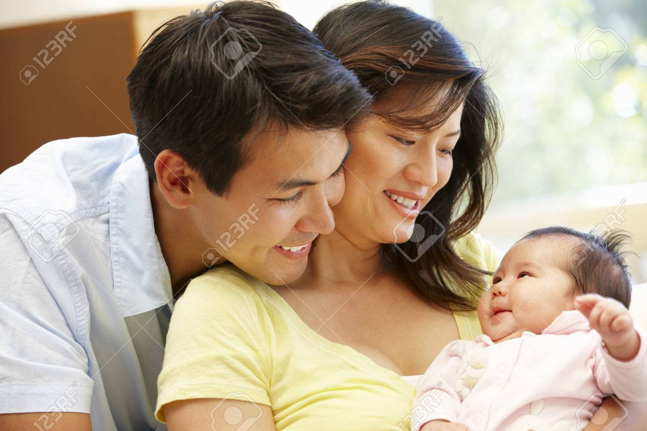 Asian couple and baby Stock Photo - 42109089