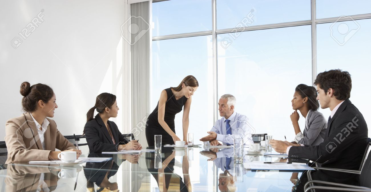 Group Of Business People Having Board Meeting Around Glass Table Stock Photo - 42164246