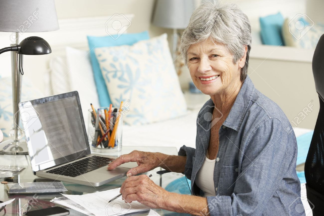 Cool Senior Woman Working In Home Office Stock Photo Picture And Largest Home Design Picture Inspirations Pitcheantrous