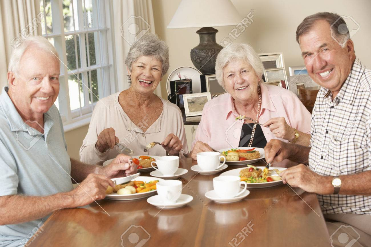 Group Of Senior Couples Enjoying Meal Together - 42164345