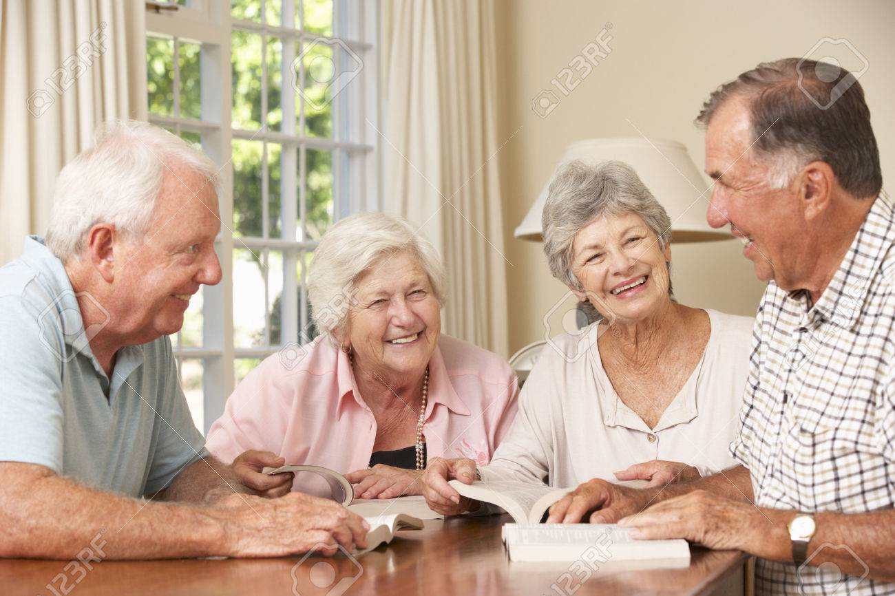Group Of Senior Couples Attending Book Reading Group Stock Photo - 42163977
