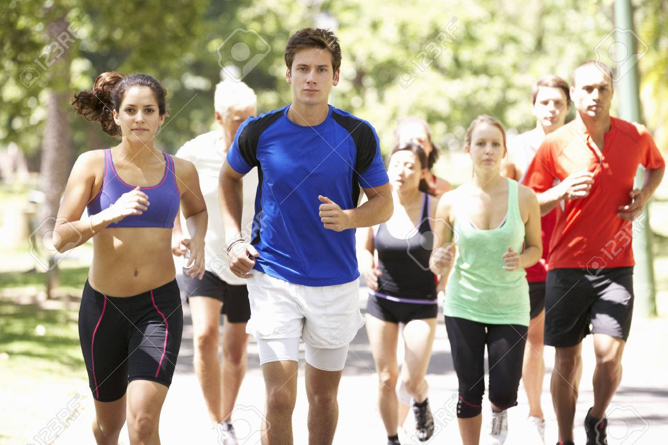 Group Of Runners Jogging Through Park Stock Photo - 42401653