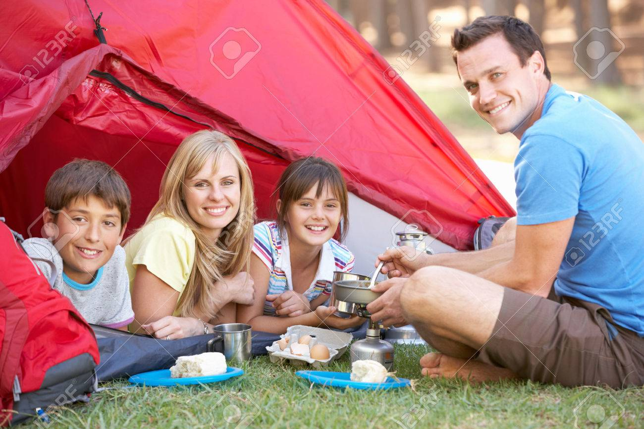 Family Cooking Breakfast On Camping Holiday - 42249044