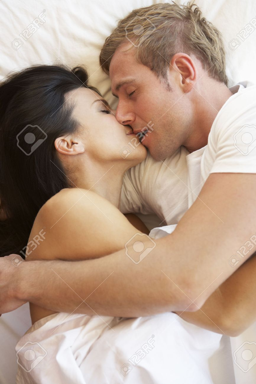 Passionate Couple Kissing In Bed Stock Photo   42251305