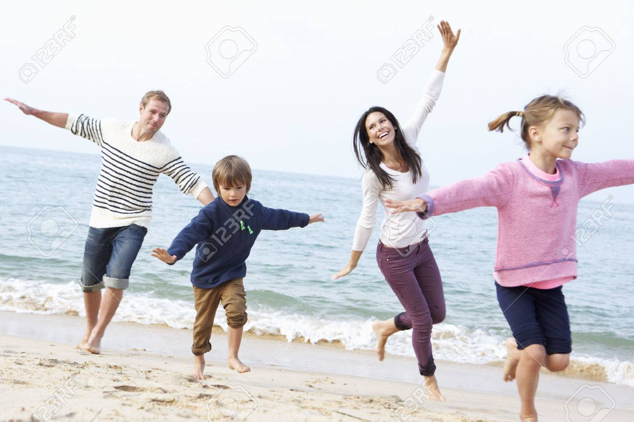 Family Playing On Beach Together Stock Photo - 42256948