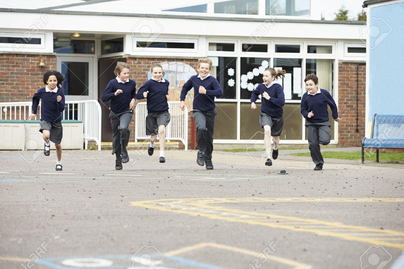 Group Of Elementary School Pupils Running In Playground Stock Photo - 42401807