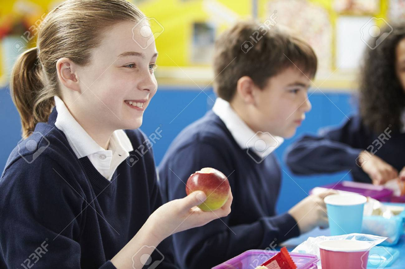 Schoolchildren Sitting At Table Eating Packed Lunch Stock Photo - 42401972