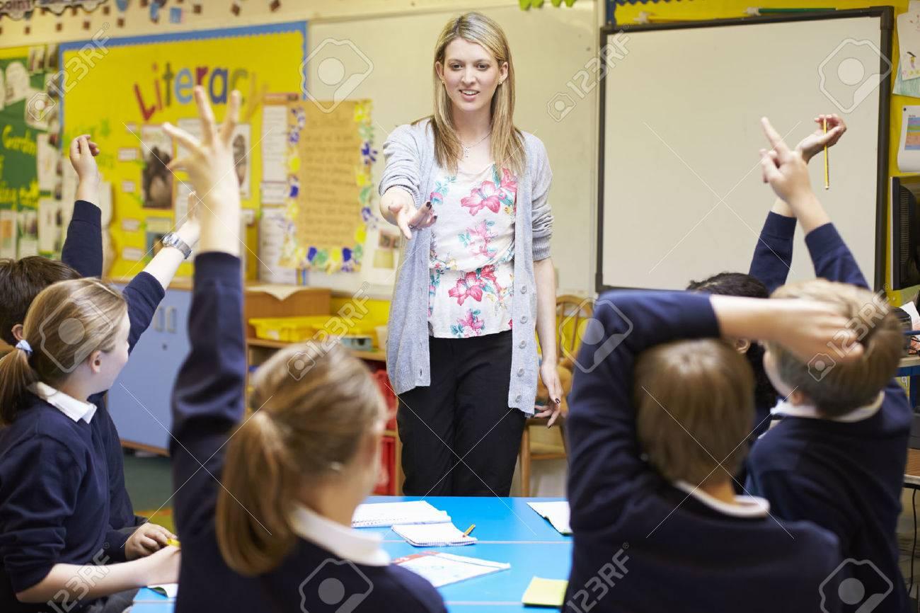 Teacher Teaching Lesson To Elementary School Pupils Stock Photo - 42402525