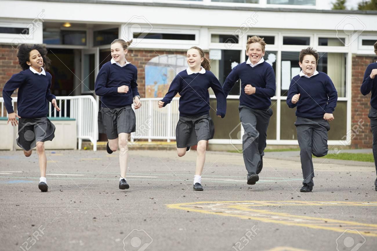 Group Of Elementary School Pupils Running In Playground Stock Photo - 42402528
