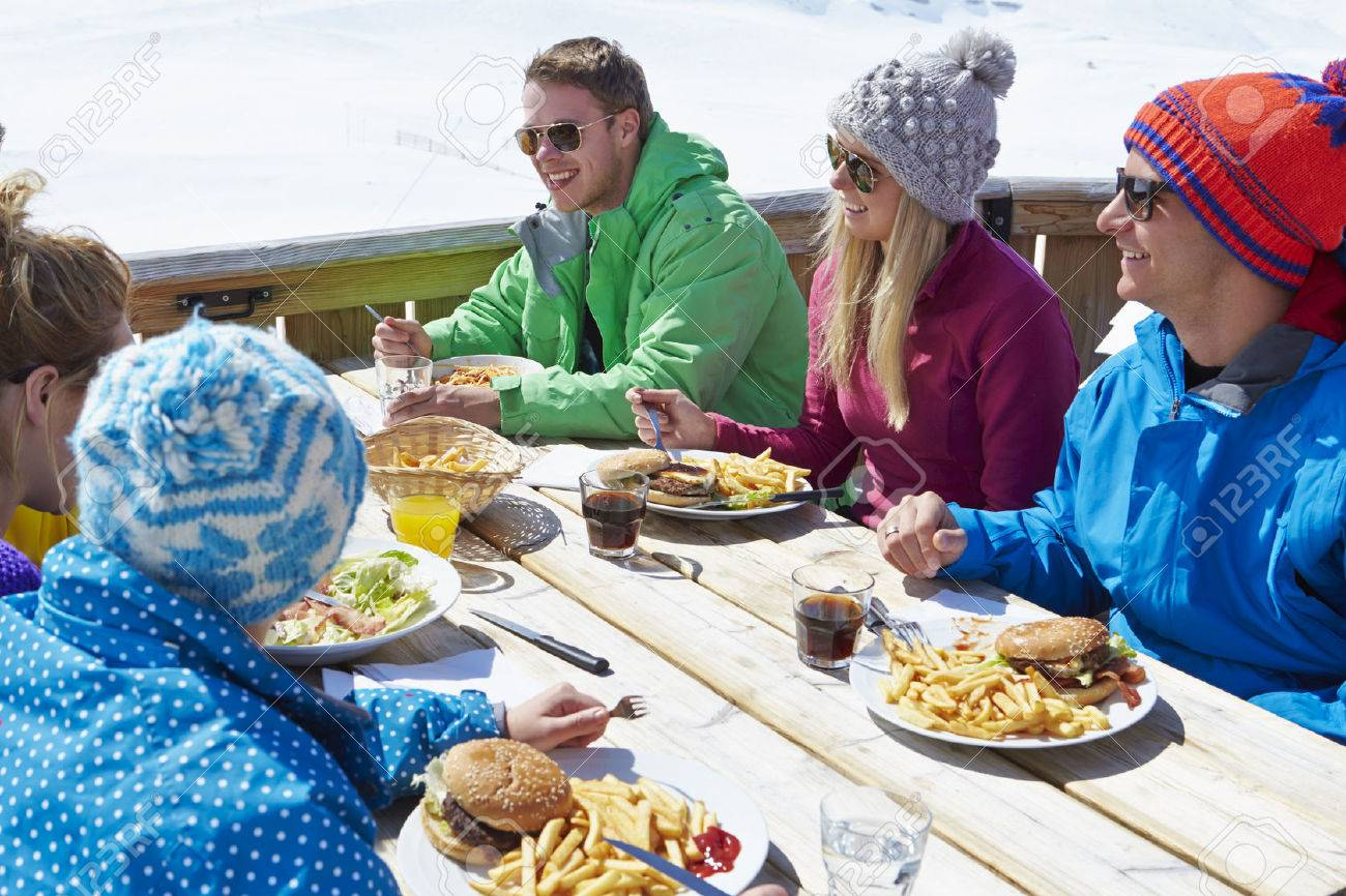 Group Of Friends Enjoying Meal In Cafe At Ski Resort Stock Photo - 42402552