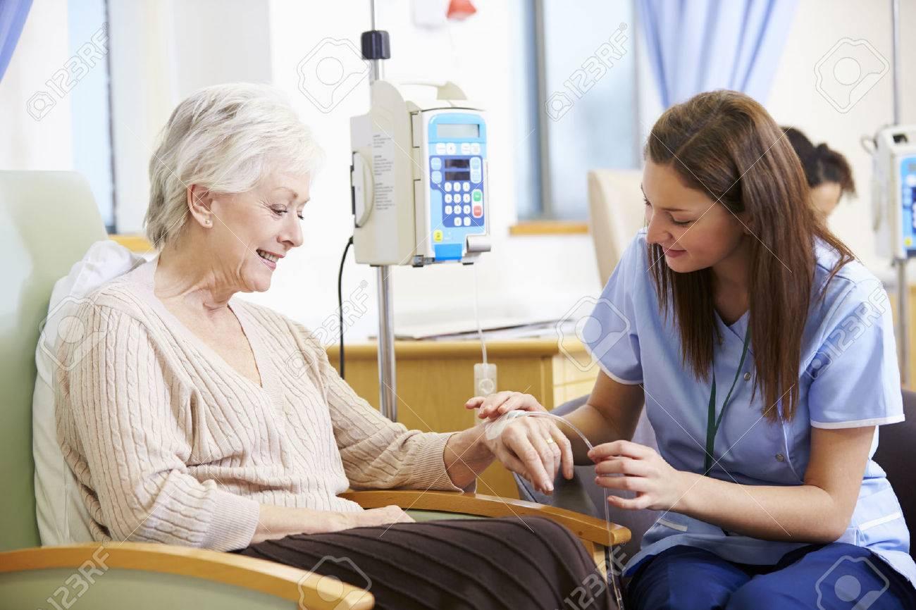 Senior Woman Undergoing Chemotherapy With Nurse Stock Photo - 42402611