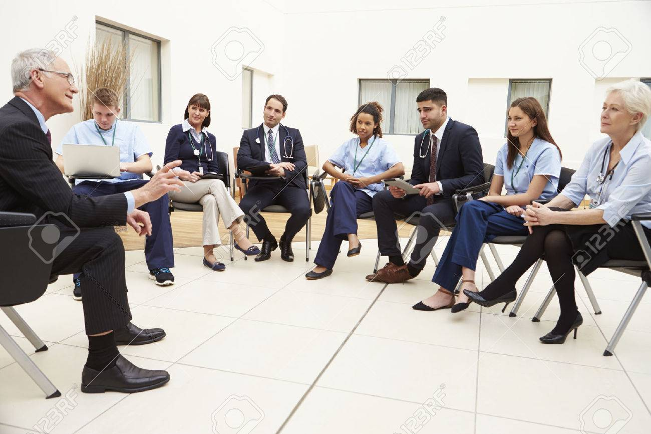 Members Of Medical Staff In Meeting Together Stock Photo - 42402616