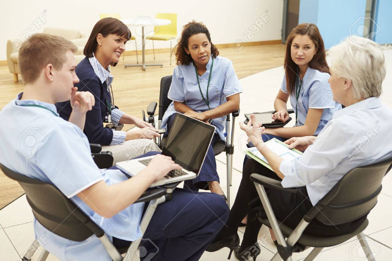 Members Of Medical Staff In Meeting Together Stock Photo - 42402894