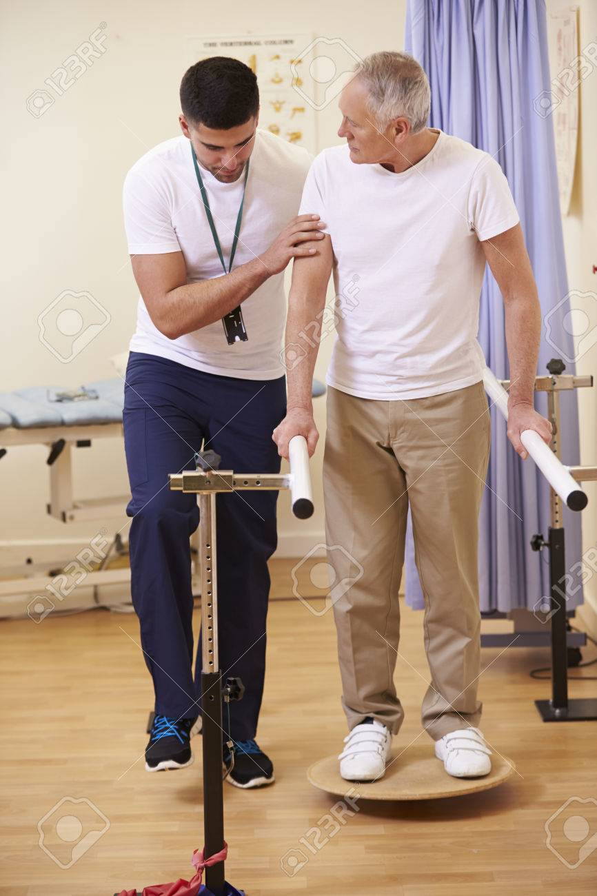 Senior Male Patient Having Physiotherapy In Hospital Stock Photo - 42402950