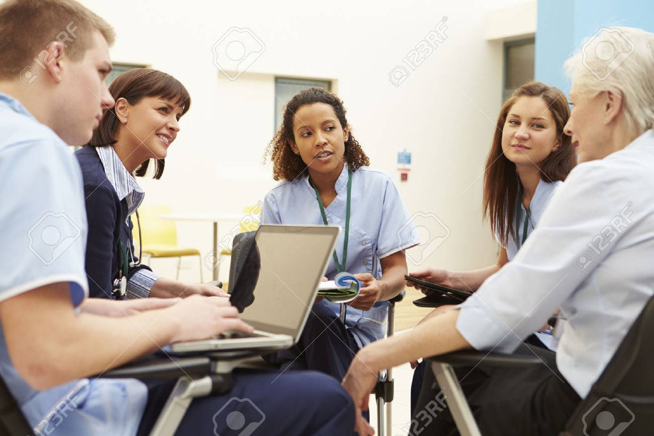 Members Of Medical Staff In Meeting Together Stock Photo - 42402979