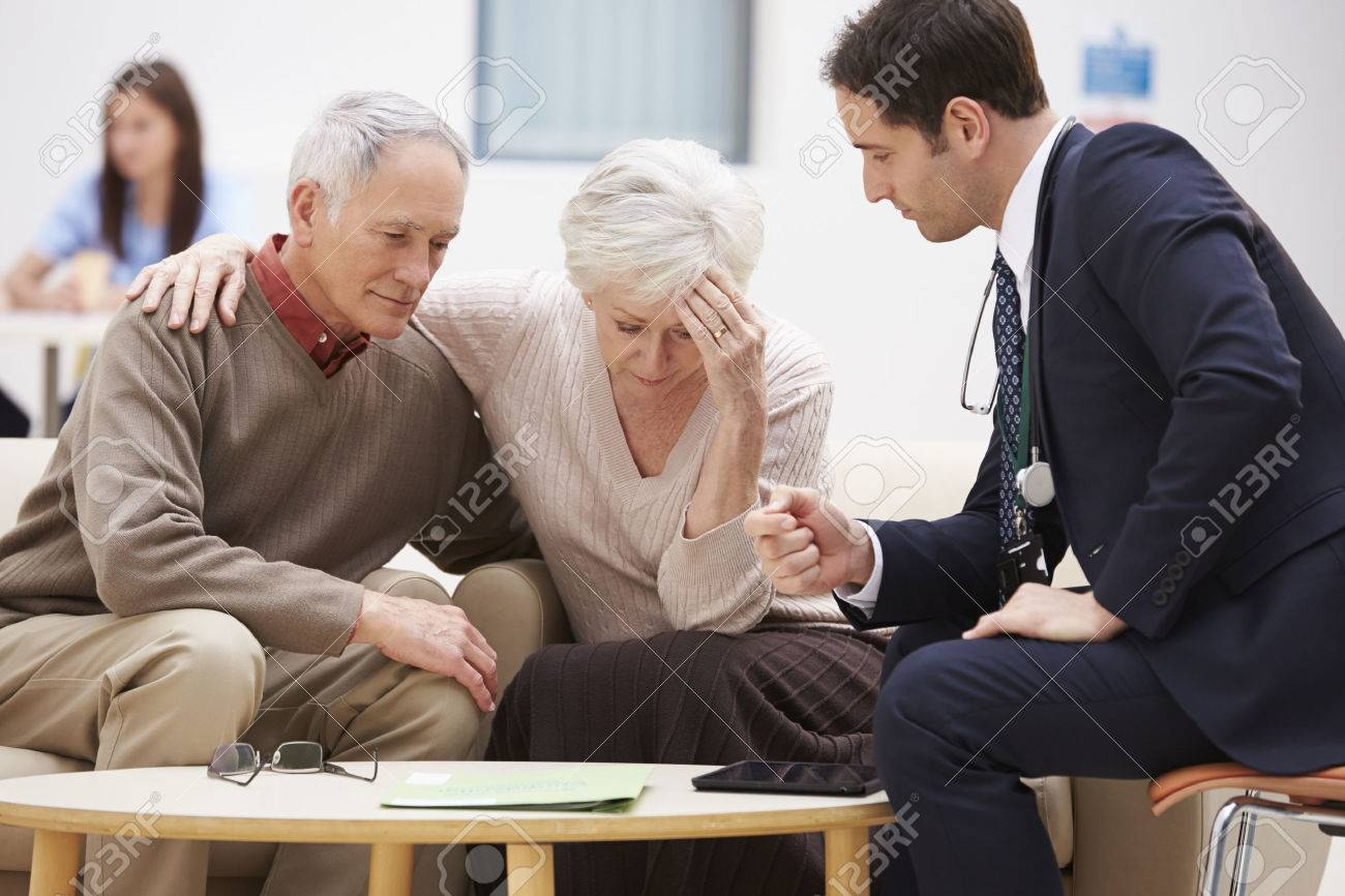 Senior Couple Discussing Test Results With Doctor Stock Photo - 42403001