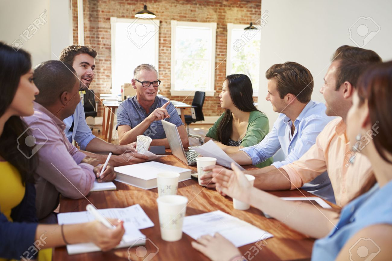 Group Of Office Workers Meeting To Discuss Ideas Stock Photo
