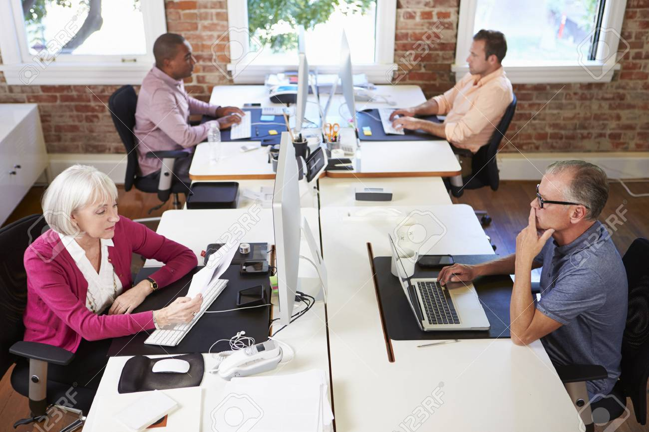 Group Of Workers At Desks In Modern Design Office Stock Photo Picture And Royalty Free Image Image 42307767
