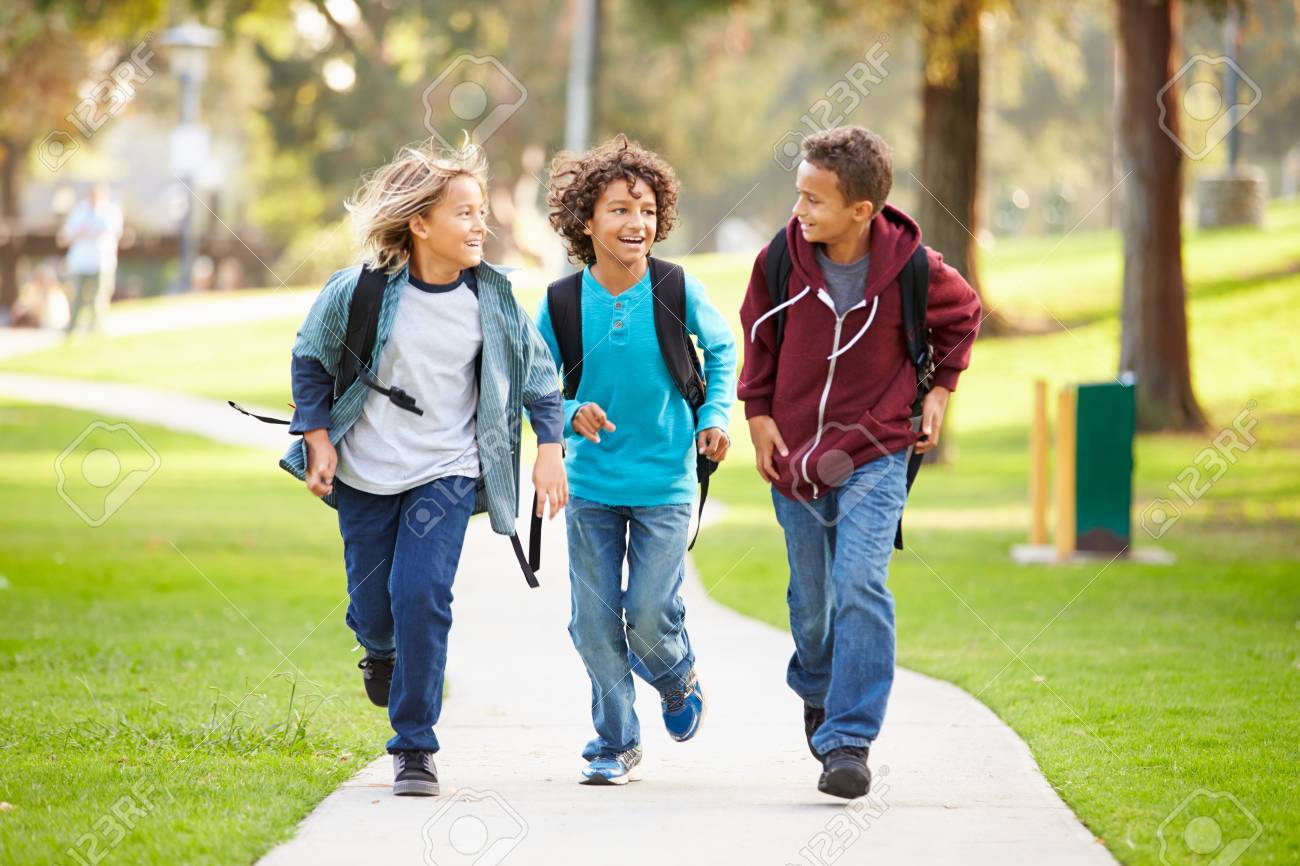 Group Of Young Boys Running Towards Camera In Park Stock Photo, Picture And  Royalty Free Image. Image 42310019.
