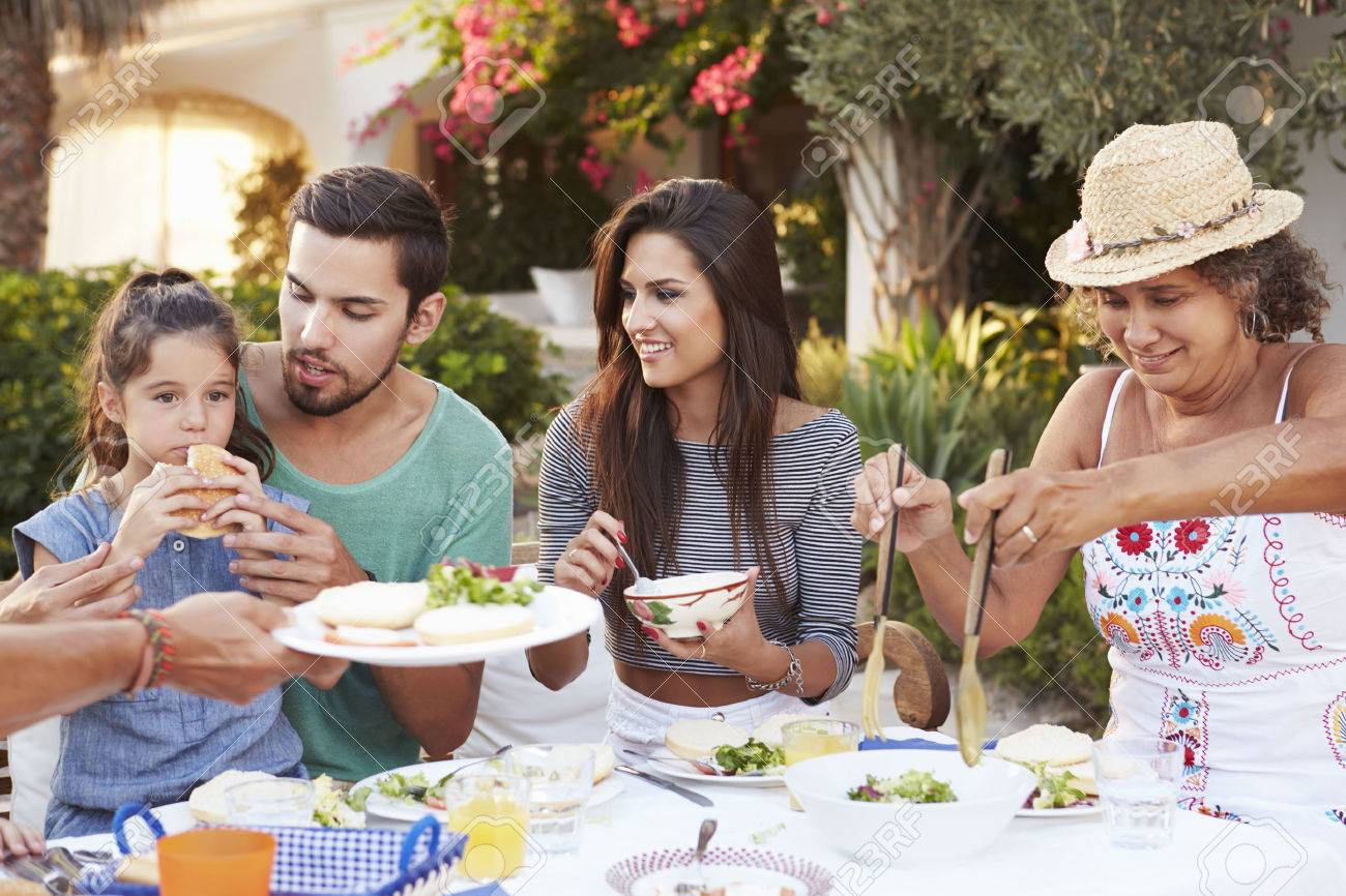 Multi Generation Family Eating Meal At Outdoors Together Stock Photo - 42314749