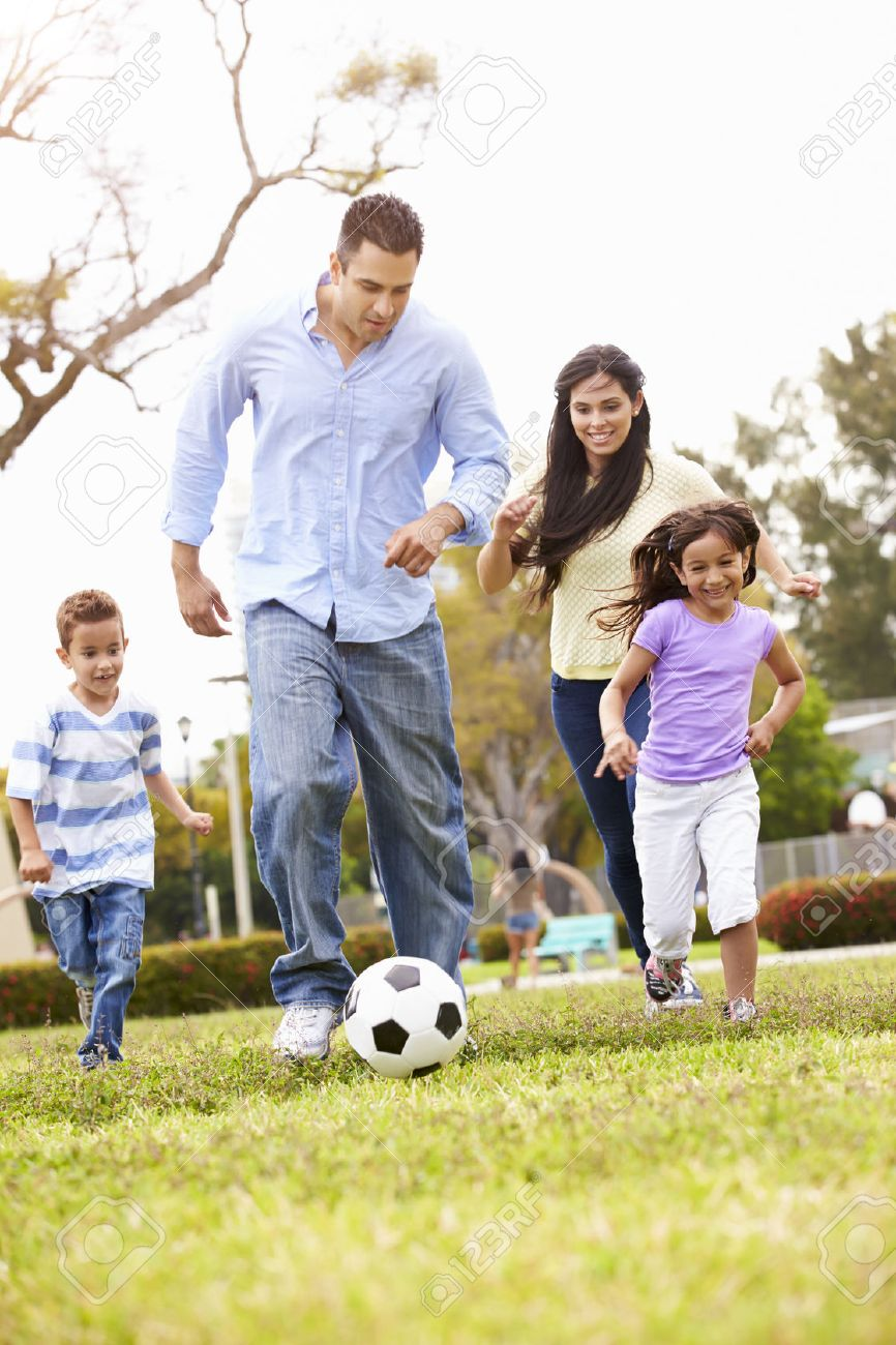 Hispanic Family Playing Soccer Together Stock Photo - 42314863