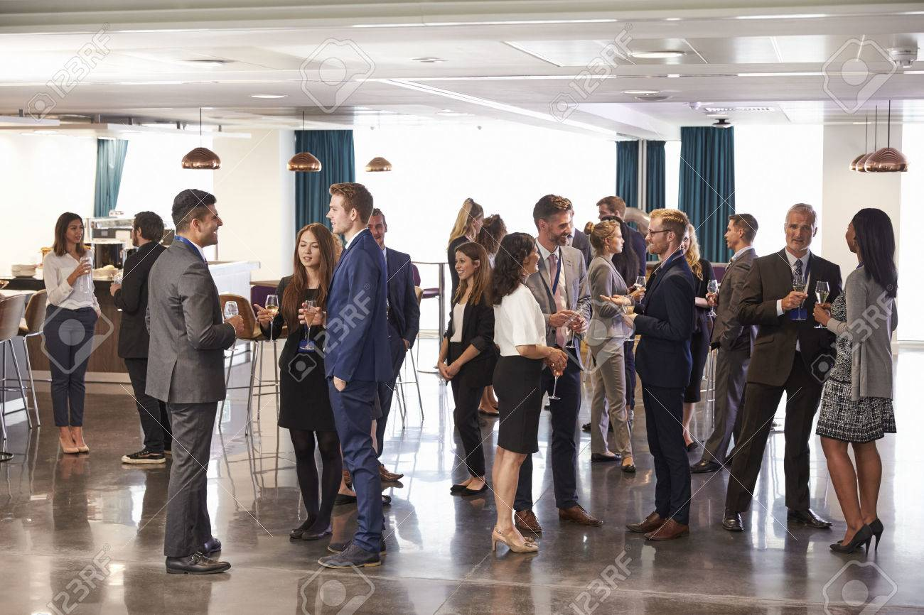 Delegates Networking At Conference Drinks Reception - 71235878