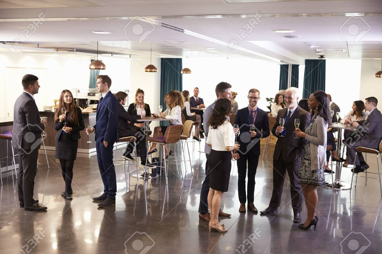 Delegates Networking At Conference Drinks Reception - 71235887