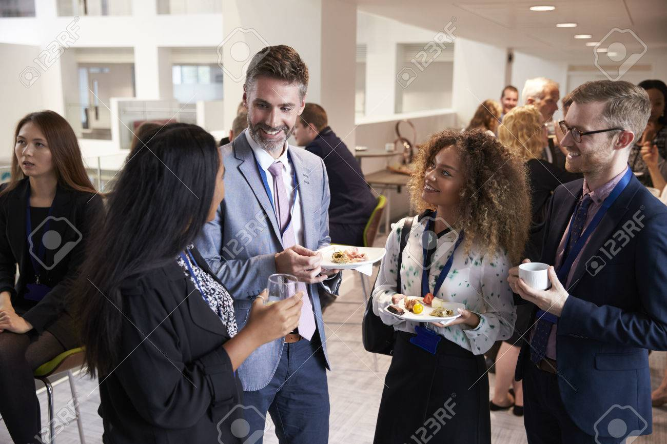 Delegates Networking During Conference Lunch Break Stock Photo - 71258922