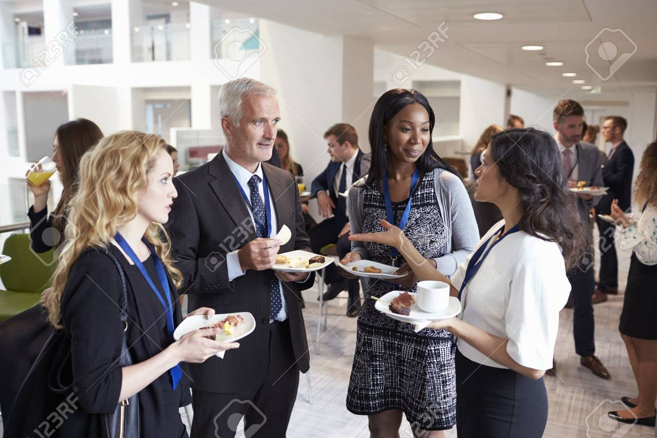 Delegates Networking During Conference Lunch Break Stock Photo - 71258997
