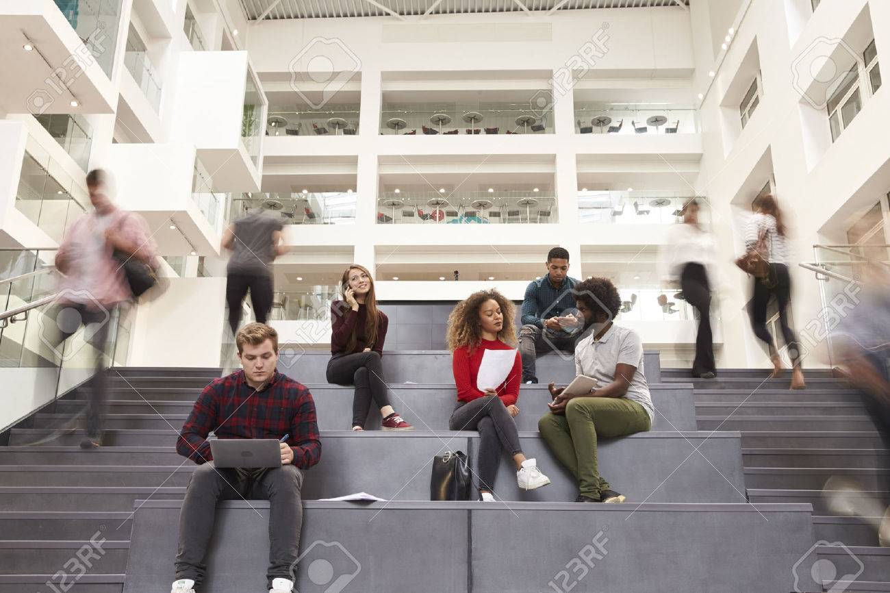 Interior Of Busy University Campus Building With Students Standard-Bild - 71304813