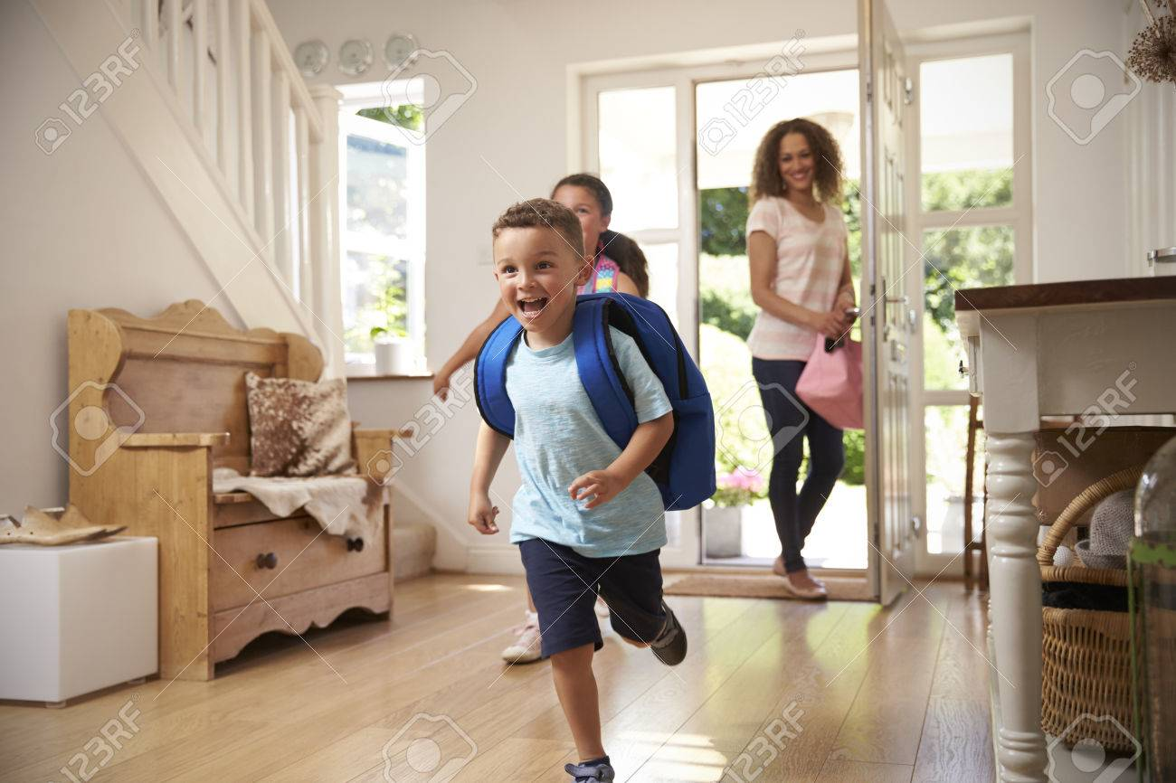 Excited Children Returning Home From School With Mother Standard-Bild - 71214448