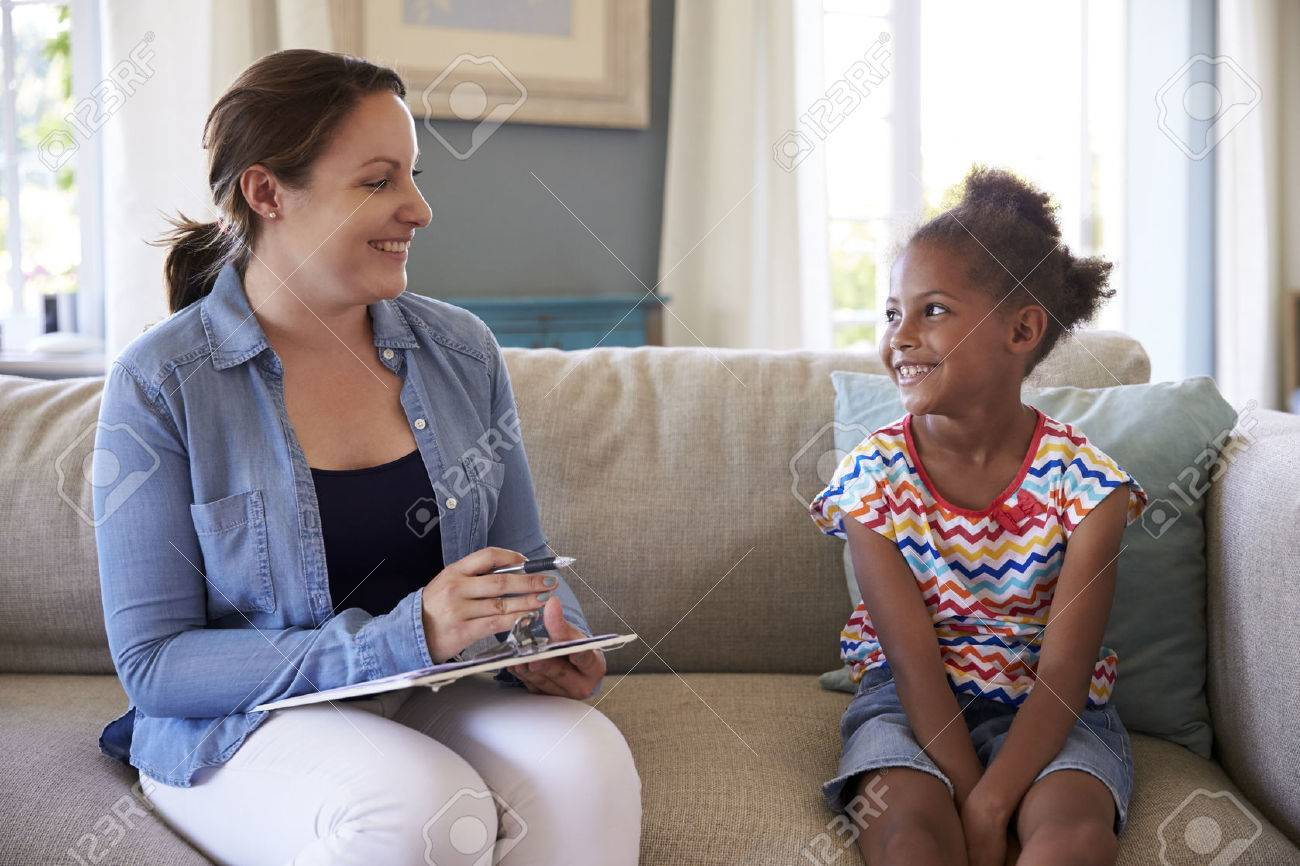 Young Girl Talking With Counselor At Home Stock Photo - 71266740