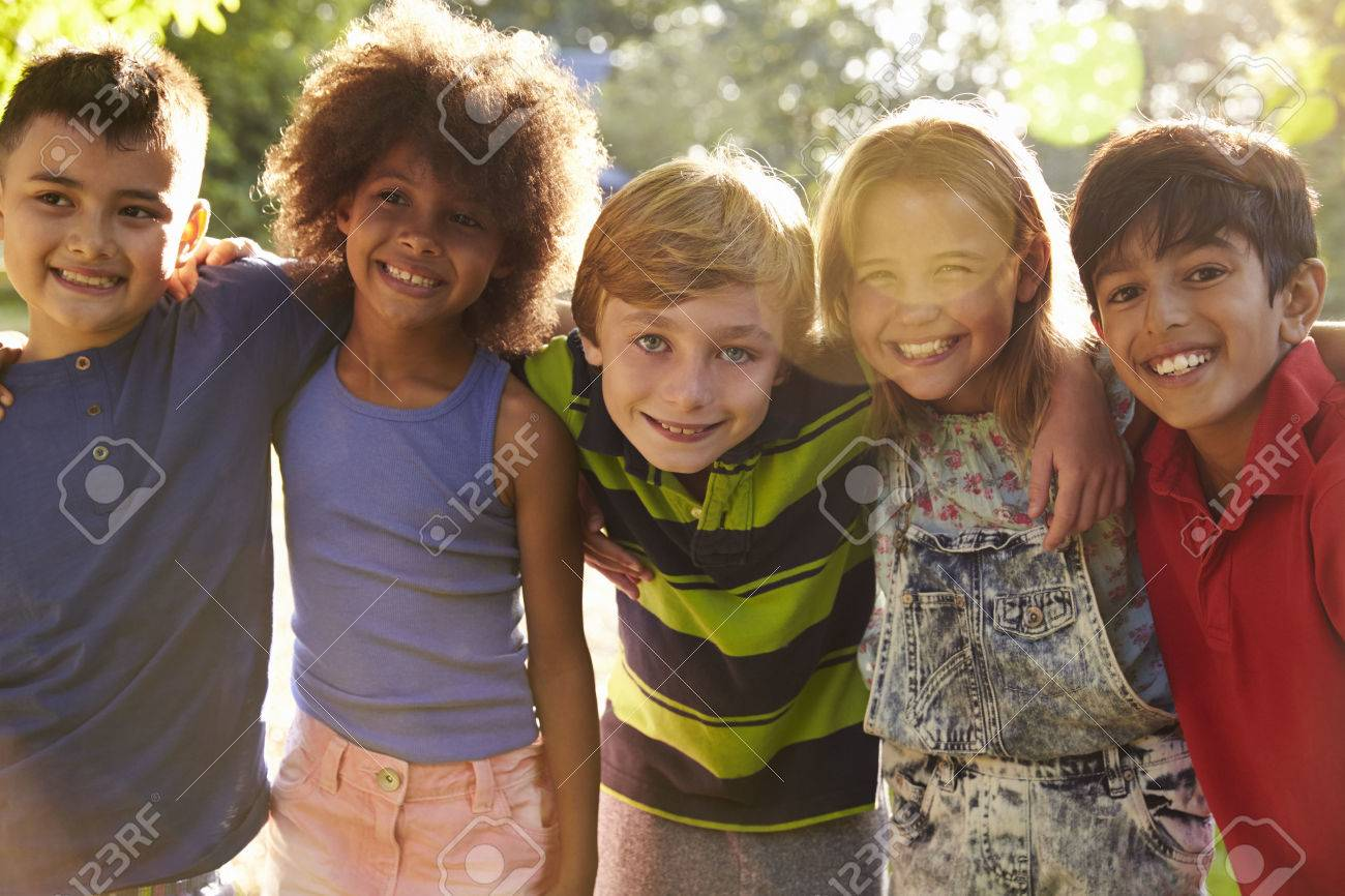Portrait Of Five Children Having Fun Outdoors Together Stock Photo - 71214956