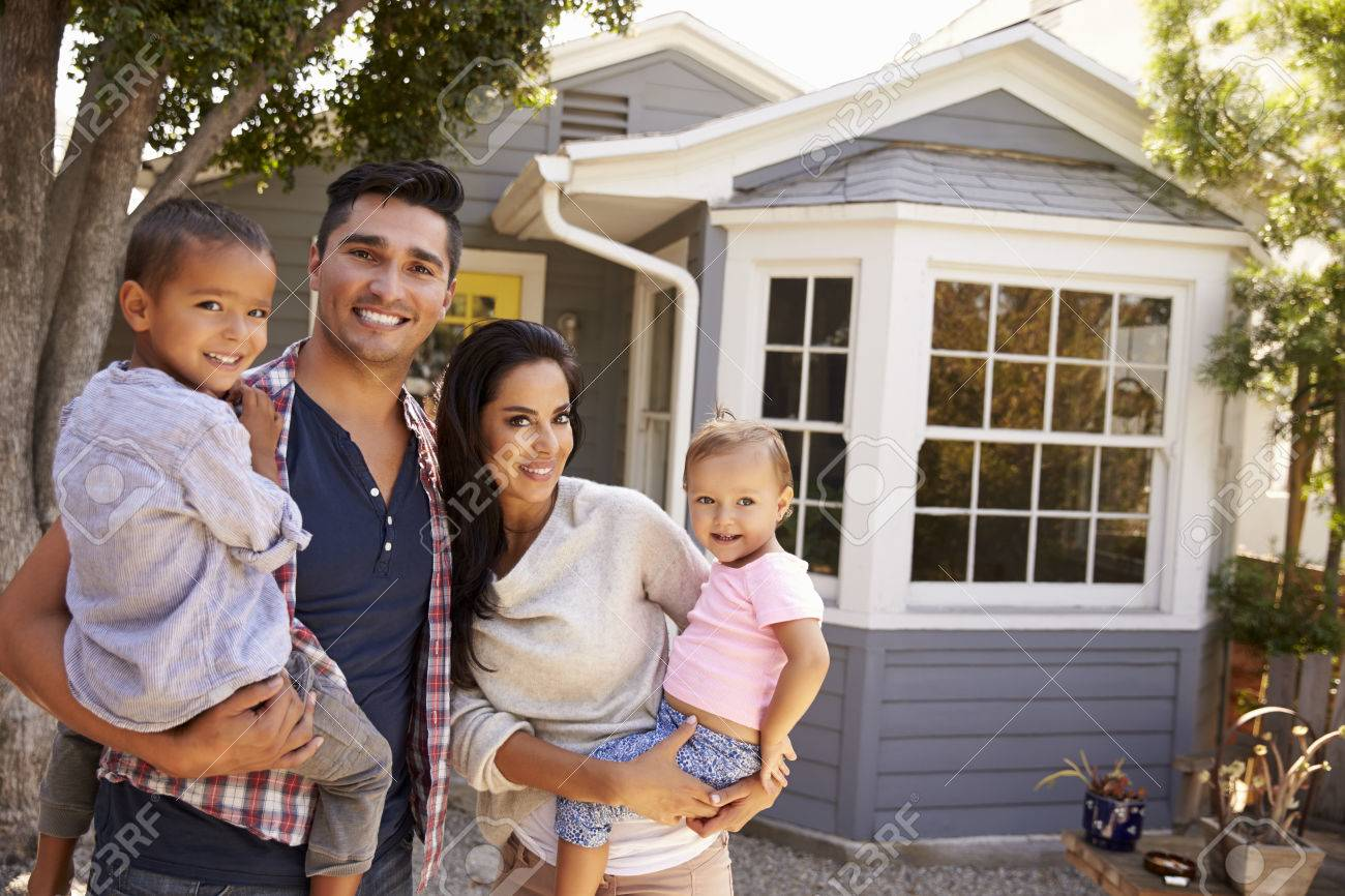Portrait Of Family Standing Outside Home Stock Photo - 71215008