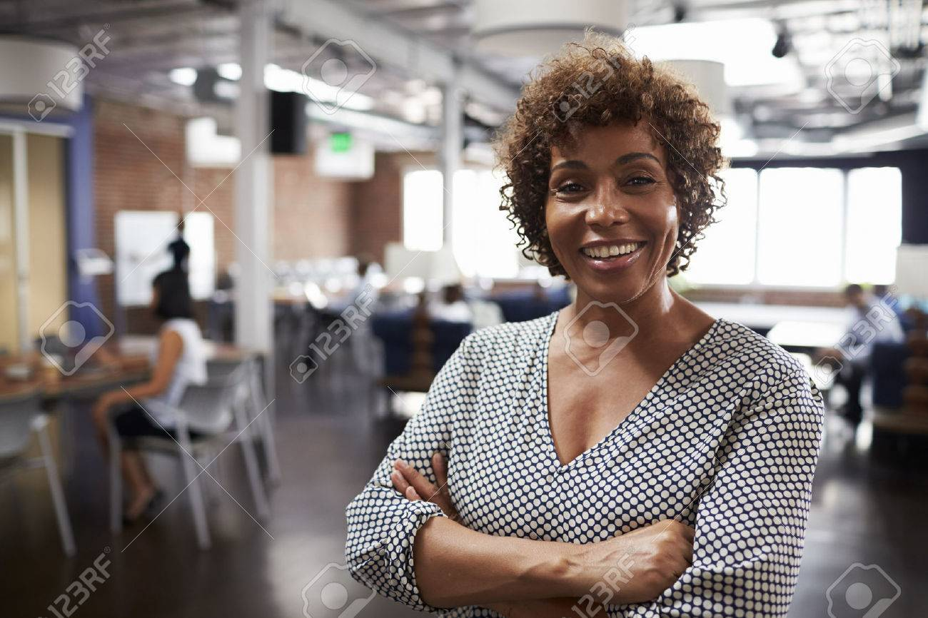 Portrait Of Mature Businesswoman In Modern Open Plan Office Stock Photo - 71279065