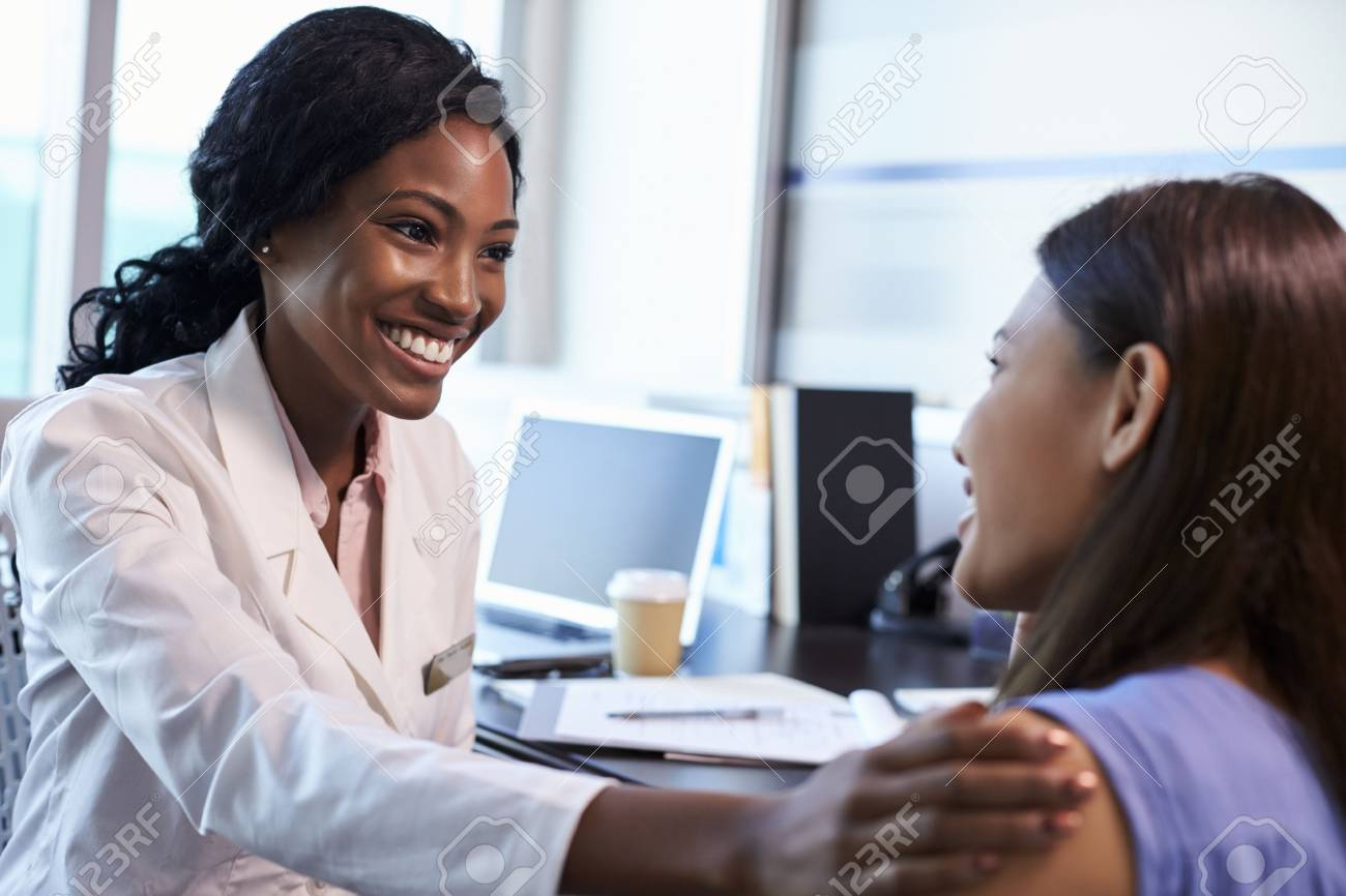 Doctor Wearing White Coat Meeting With Female Patient - 71352767