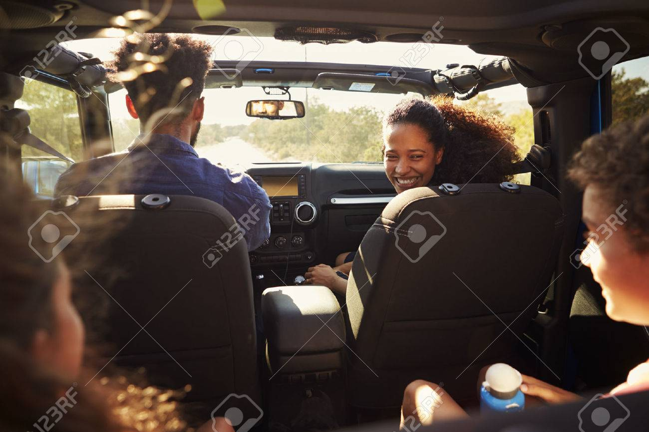 Excited family on a road trip in car, rear passenger POV Banque d'images - 71404568