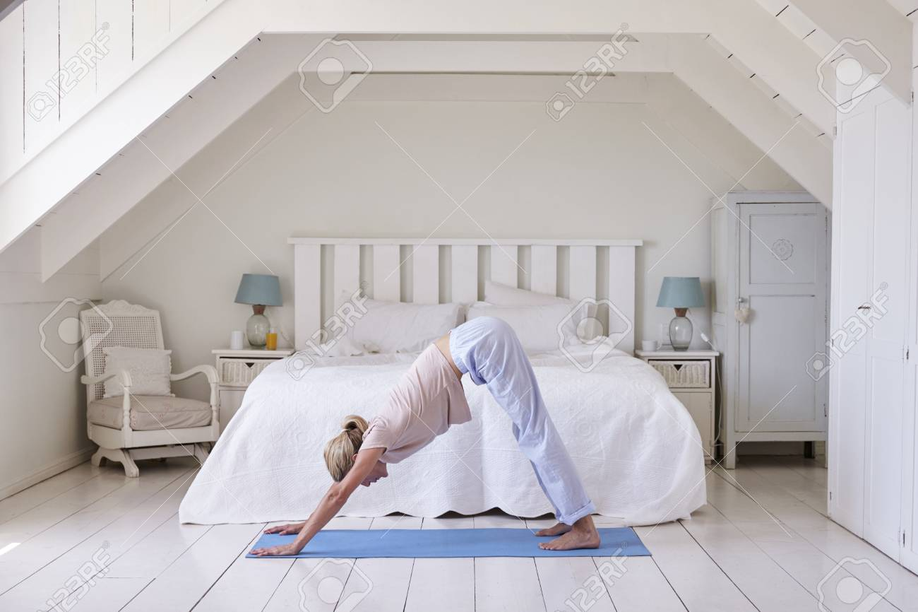 Woman At Home Starting Morning With Yoga Exercises In Bedroom Stock Photo Picture And Royalty Free Image Image 88062784