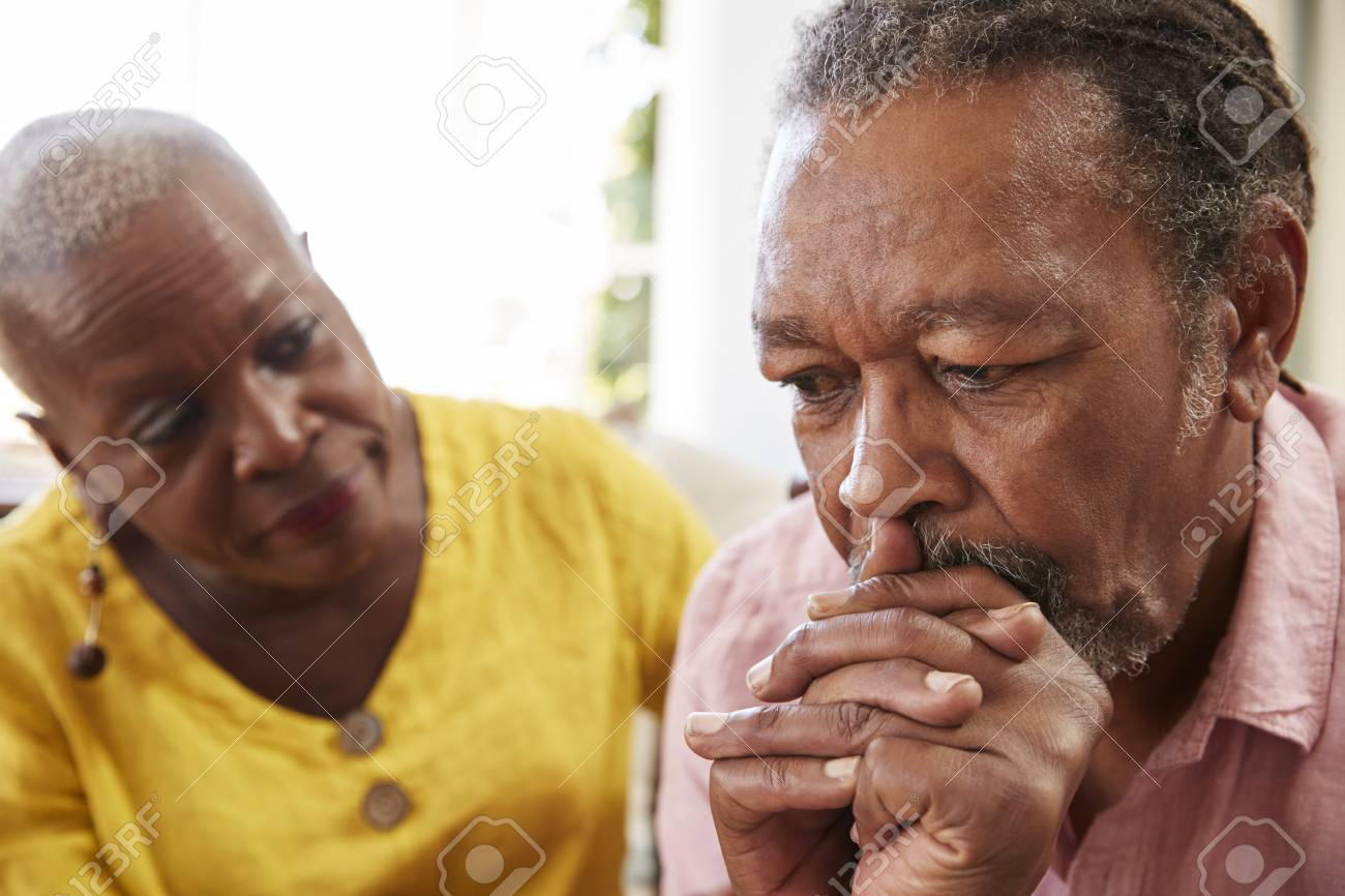 Senior Woman Comforting Man With Depression At Home - 90340507