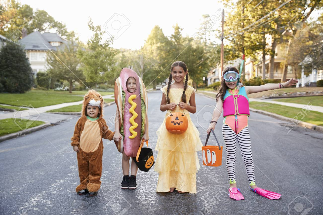 Children Wearing Halloween Costumes For Trick Or Treating - 94372535
