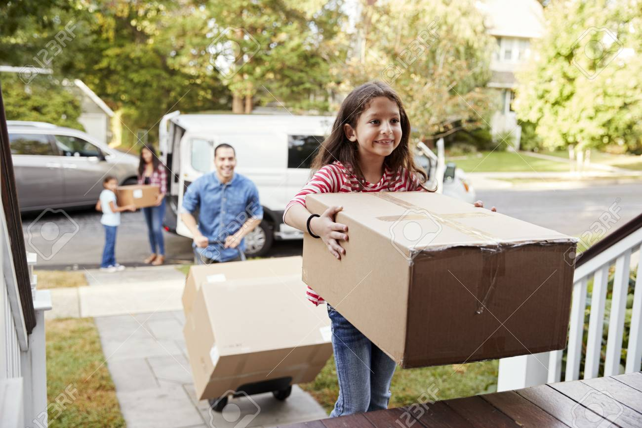 Children Helping Unload Boxes From Van On Family Moving In Day - 94361320