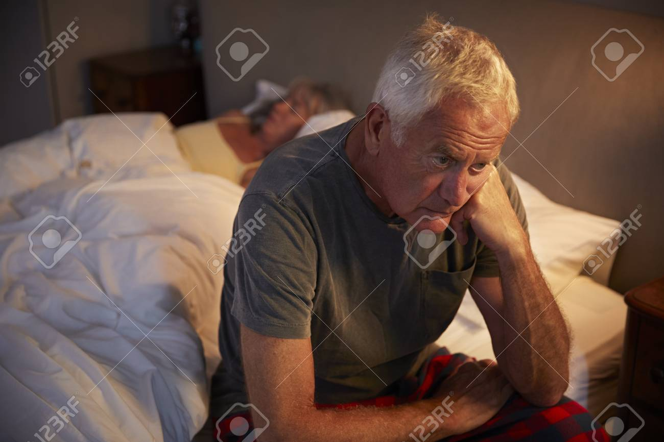 Worried Senior Man In Bed At Night Suffering With Insomnia - 96249922