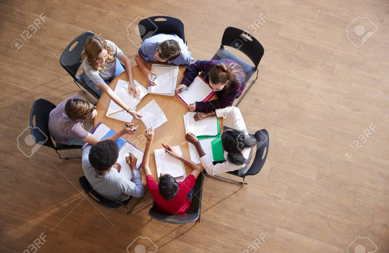 Overhead Shot Of High School Pupils In Group Study Around Tables - 104017662