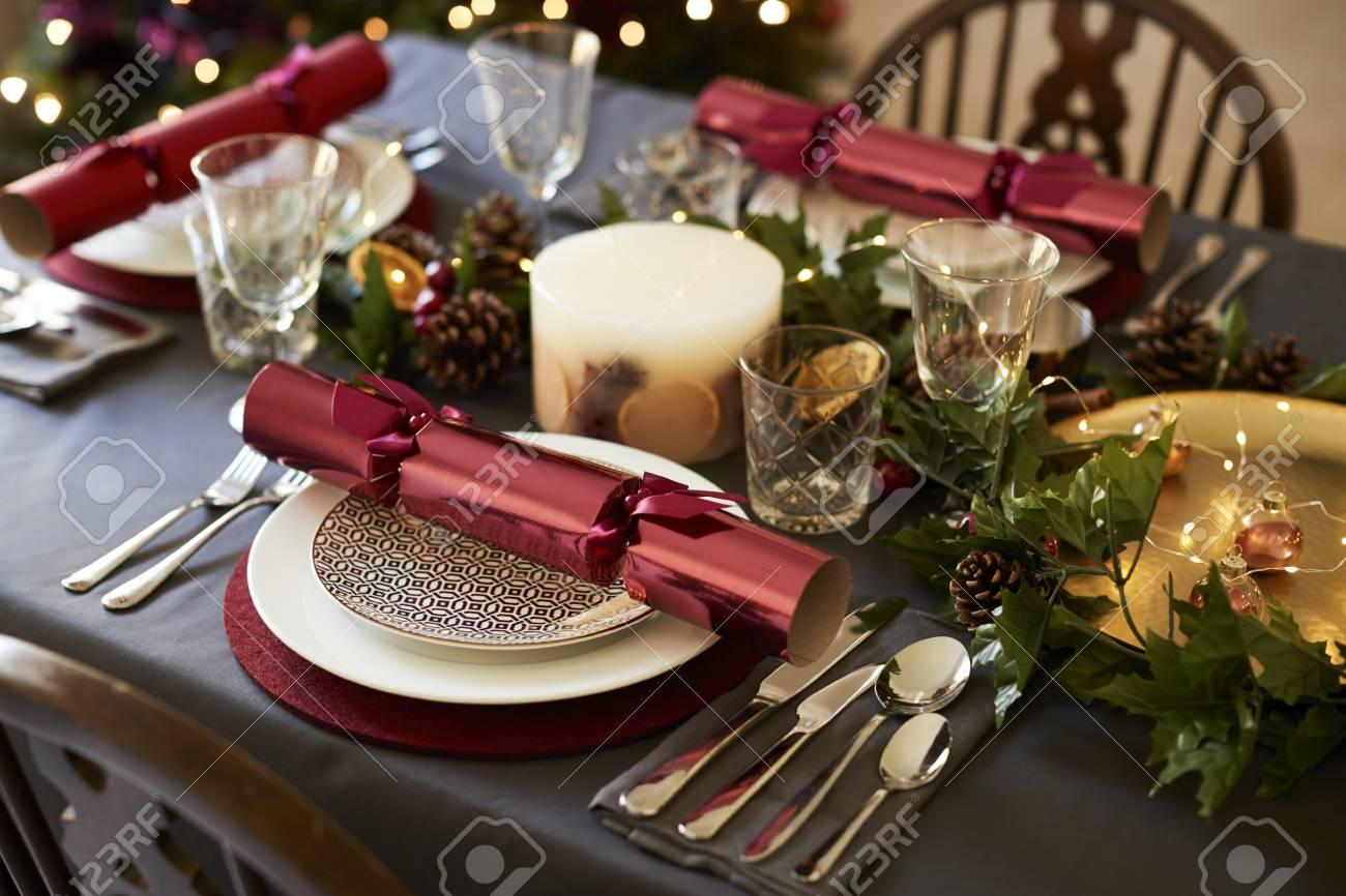 Christmas Table Settings.Close Up Of Christmas Table Setting With Christmas Crackers Arranged